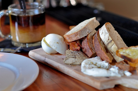 Breakfast Board (Tasty n Sons - Portland, OR) Filled with two kinds of bread, a soft boiled egg, chicken liver pate, a house made lebneh cheese, two slices of applewood smoked bacon and a pile of pickled beets. We need to make these.