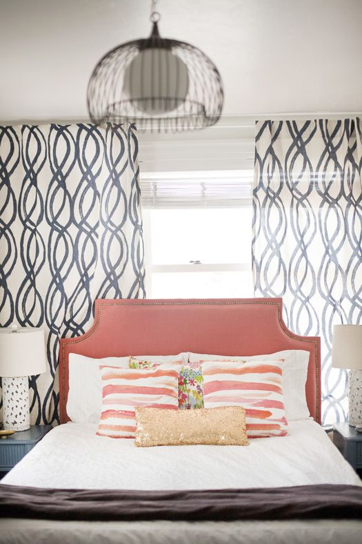coral/apricot headboard + swirl geo window panels + brushstroke pattern pillows + glam gold sequin bolster