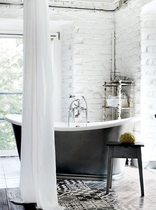 Beautiful tub. Painted white brick