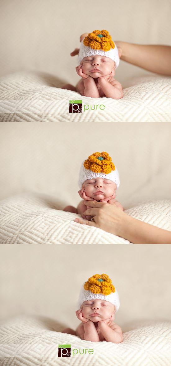 Posing a newborn baby