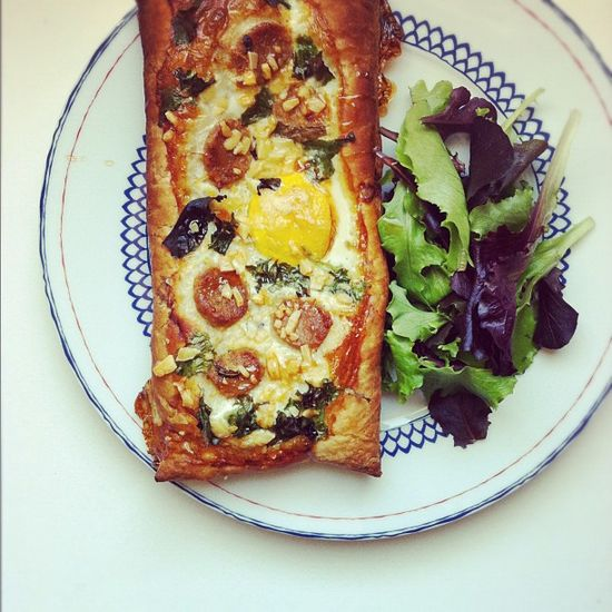 Homemade breakfast tart - egg, kimchi sausage, gruyere cheese & hot honey.