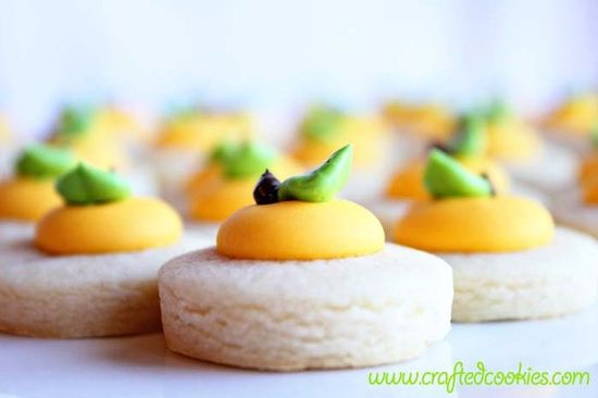 """Lemon Cookie Nibbles  This is Crafted Cookies' new line of miniature cookies.    Each one is a perfect bite site of only 1.25"""" in size and made from our buttery vanilla sugar cookie recipe & royal icing with just a hint of lemon.    These adorable miniature cookies make the perfect gift or wedding favors."""