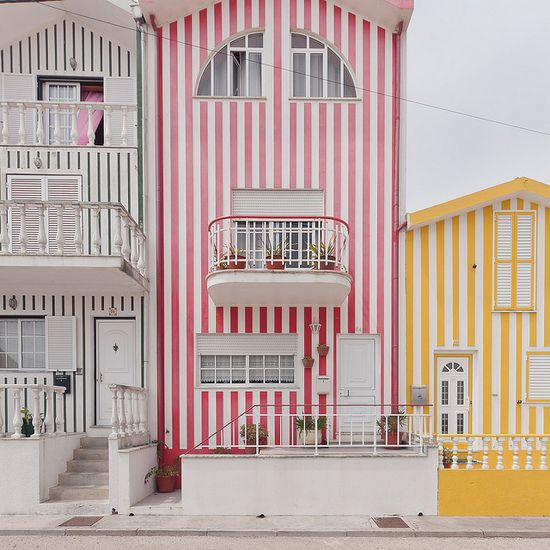 Candy striped buildings in pink and yellow