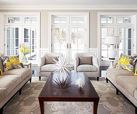 We love the bold and versatile accessories in this room! More living room designs: www.bhg.com/...