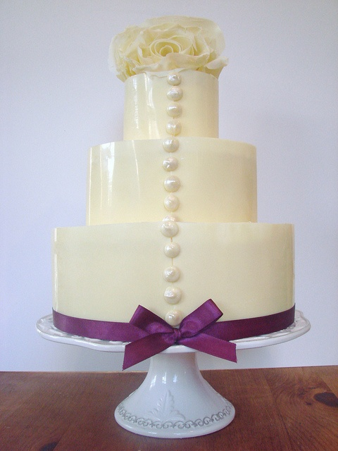 White chocolate rose wedding cake. Reminds me of the back of my dress...