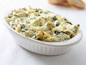 """Healthified"" Spinach Dip with Artichokes Recipe from Betty Crocker with 50% less fat, 50% less sat fat, 36% fewer calories than the original recipe. Make a dip that boasts more spinach for an extra punch of vitamins."