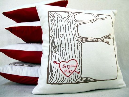 A tree with a heart and you and your loves name carved on it (embroidered).  I could do this :)