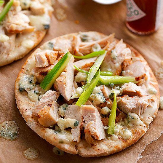 Kick up the heat with these quick and easy Buffalo Chicken Pizzas. More inexpensive chicken recipes: www.bhg.com/...