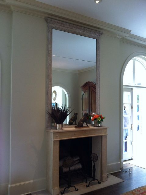Elegant tall mirror over fireplace
