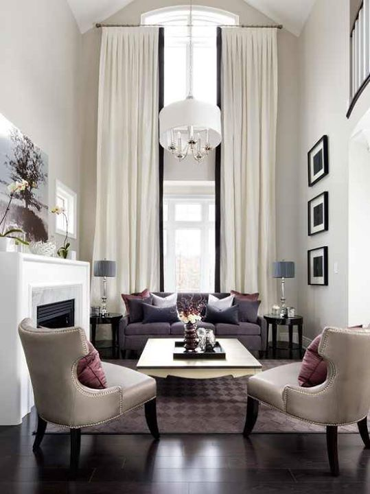 This room is beautiful, but the curtains could be fit to that archway. We have a solution for that!  www.decorteamus.com