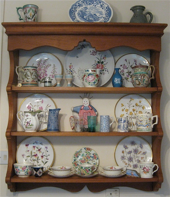 """My Kitchen Dresser top, Pottery and china collection. Stunning wild flower plates from Coalport. Denby jugs and mug, vintage Glyn Colledge, Wooden Granny , hand made gift from my daughter. """"Grannies are antique little girls"""""""