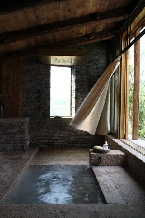 This is a bathroom!  Look at the tub, stone walls, open window, curtains...beautiful via: Life is in everything beautiful