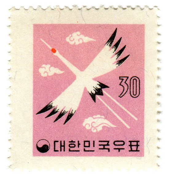 Korea postage stamp: bird and pink sky circa 1959