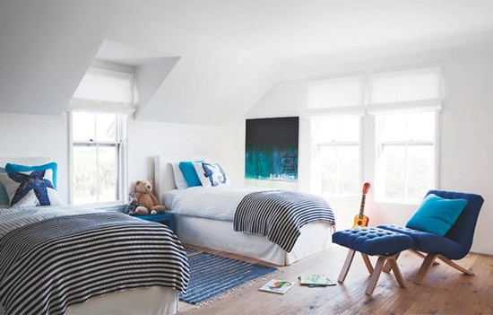 All white bedroom with royal blue + teal + black and white stripe throw