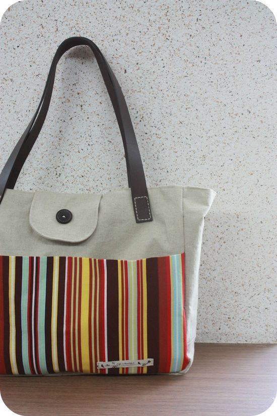 Tutorial: DIY Tote with Leather Straps    You can also find even more listings for free purse patterns and tutorials here at www.free-purse-pa...