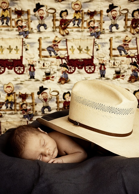 Little cowboy..Baby P with daddy's cowboy hat