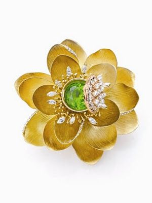 the pearl & diamond encrusted lid actually opens on this lotus brooch by jewelry designer Mish Tworkowski. Mish Jewelry, NY