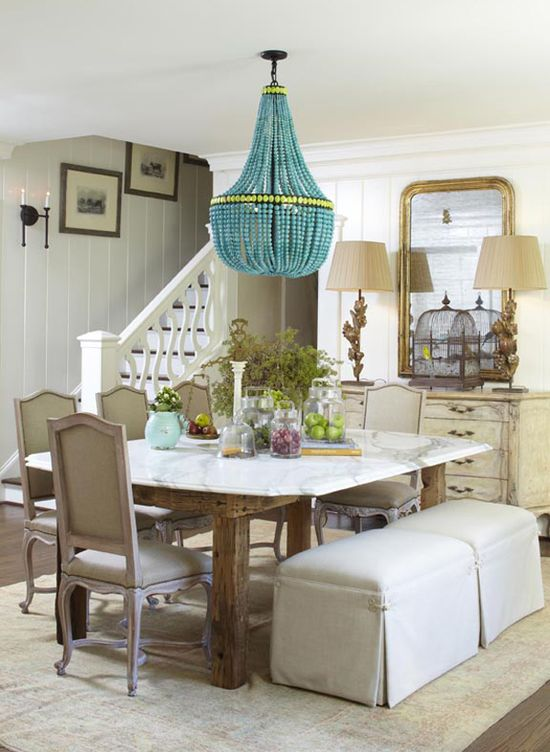 A traditional dining room gets an update from this bold chandelier. (www.hgtv.com/...)