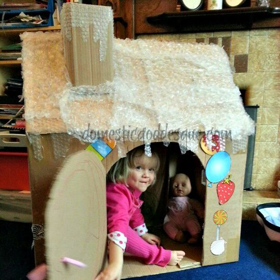 {Too Cute} It's a giant gingerbread house made from a cardboard box - with bubble wrap roof.  Kids would love this.