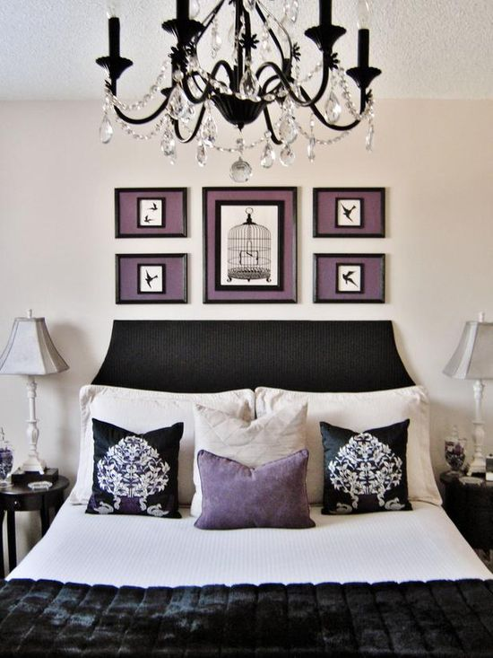We love the black painted chandelier. This stylish bedroom was designed on a budget. See more: www.hgtv.com/...