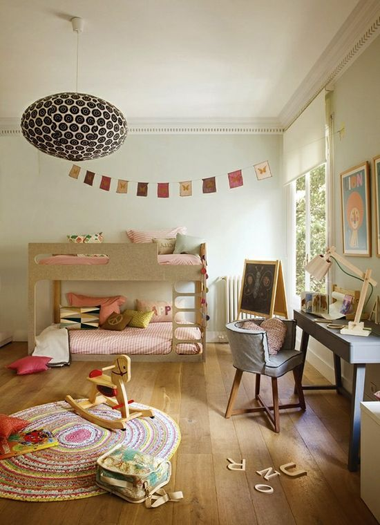 Soft and neutral room for girls.