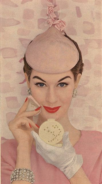 The whimsical pink hat in this 1950s Max Factor ad is absolutely delightful (as is the model's timelessly pretty make-up). #vintage #1950s #makeup #hat #fashion