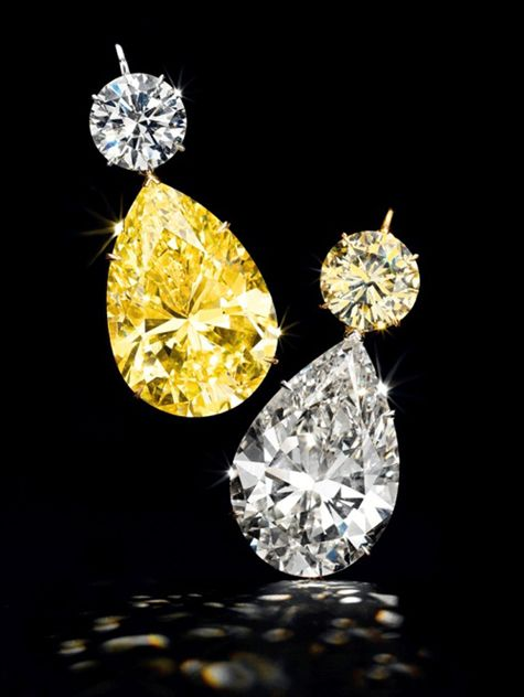 Diamond ear pendants with 52.78-carat and 50.31-carat pear-shaped diamonds (117.04 carats total with surmounts), Christie's
