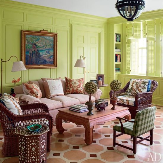 Buatta created a painted floor for a sitting room at the Rosses' Southampton house and glazed the paneling pistachio-green; the wicker chairs are by Bielecky Brothers, the child's armchair is covered in a Cowtan & Tout check, and the octagonal inlaid table is from John Rosselli Antiques.