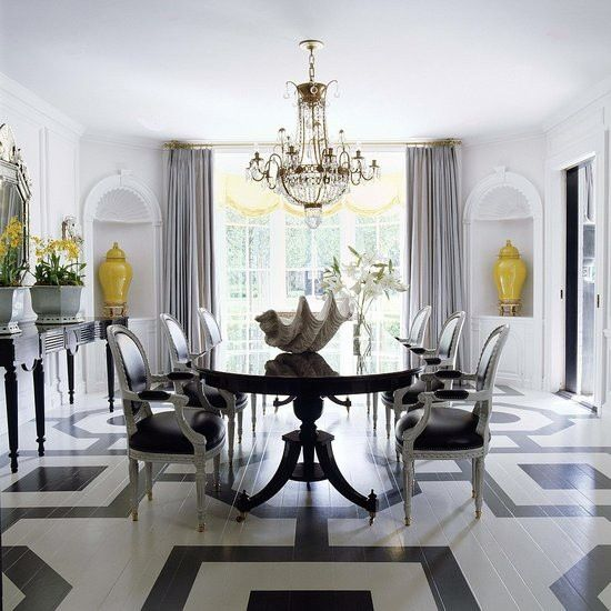 So many great elements in this room ... giant clam shell, yellow vases, venetian mirror, painted floor, crystal chandelier.