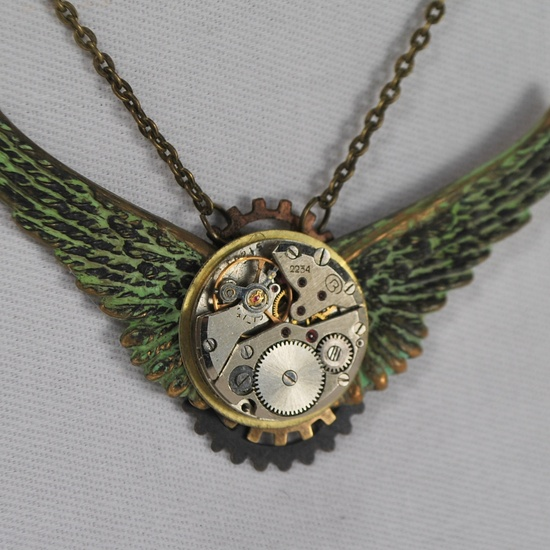 Steampunk Angel Wings Patina Carrying Vintage Watch Movements. $27.00, via Etsy.  From my pal, Sam Hamp