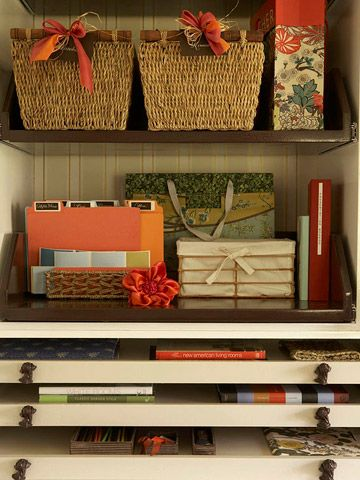 """Clutter Buster Crafts Closet - Extra shelving in a linen closet can transform the space into craft storage. Pretty baskets, bins, and boxes bust clutter while remaining visually pleasing. Short drawers can hold oversize craft papers, half-completed album pages, photos, portfolios, journals, watercolors, and canvases."""