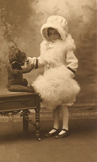 Girl with teddy bear. Vintage American photo, Julesburg, Colorado studio, c. 1920. The bear looks like a Steiff to me.