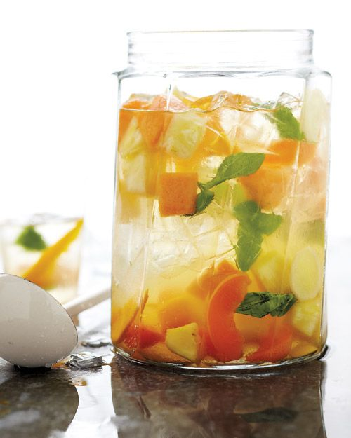 Summer Fruit Sangria:  * 6 cups assorted fruits (such as mango, pineapple, cantaloupe, and apricot), sliced or cut into chunks  * 1/4 cup thinly sliced peeled fresh ginger  * 1 to 1 1/2 cups fresh basil or mint leaves  * 1/2 cup orange liqueur, such as Cointreau  * 1 bottle crisp white wine, such as Sauvignon Blanc or Pinot Grigio  * 3 tablespoons fresh lemon juice (from 1 lemon)  * Ice