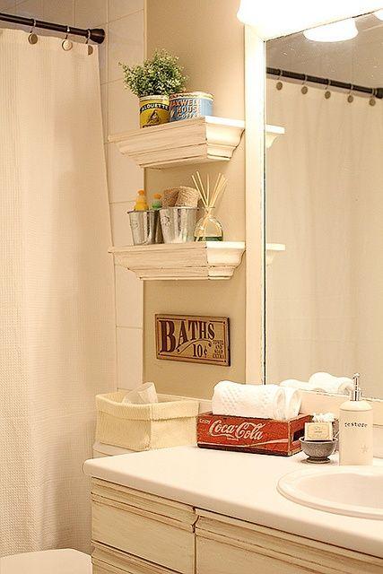 small shelves above toilet as an alternative to those units that go around the toilet.