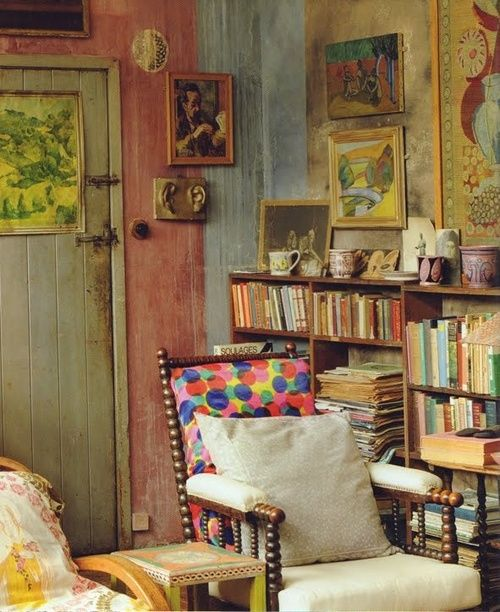 books, art, comfy chairs, mismatched patterns, the wear of living.
