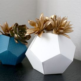 """Add a touch of gold gilding liquid to faux succulents and """"pot"""" them in origami planters you made yourself! A fun kids' project too."""