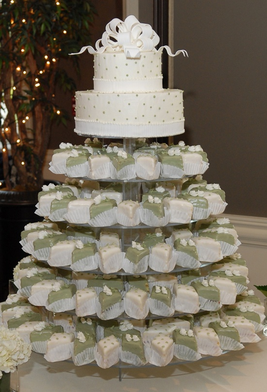 Petit four wedding cake... with a different top portion set up and with icing ribbons around each white square in wedding colors