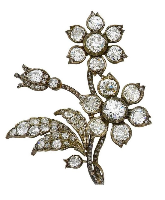 A diamond spray brooch, circa 1840   Composed of two blooms, two buds and three leaves, set throughout with cushion-shaped and old brilliant-cut diamonds, and one pear-shaped diamond, the winding stems set with rose-cut diamonds, some in closed-back settings, mounted in silver and gold,