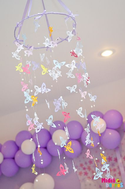 Gorgeous butterfly hanging at a Garden party!   See more party ideas at CatchMyParty.com!  #partyideas  #garden