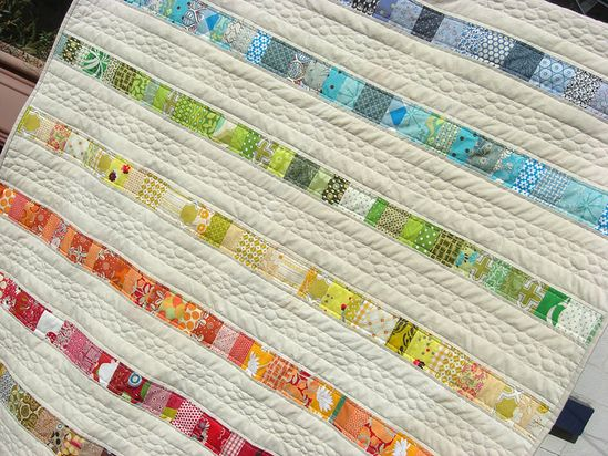great simple scrap quilt - now those are small scraps!