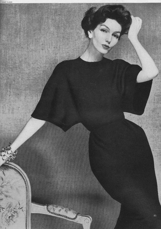 Joanna McCormick, March Vogue 1957    Wearing a basket-weave wool dress with straight tunnel sleeves by Madame Grès.