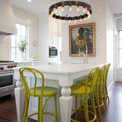 kitchen with a pop of stools