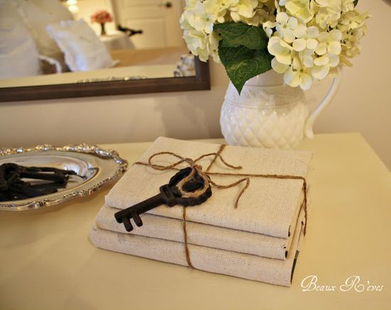 Covered books wrapped with twine and vintage key