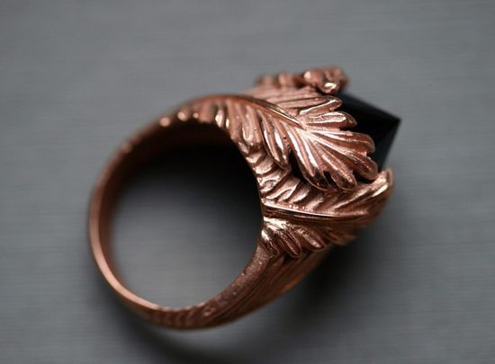 "A swirling vintage setting in rose gold is married to an inverted CZ ""diamond"" — $180.00."