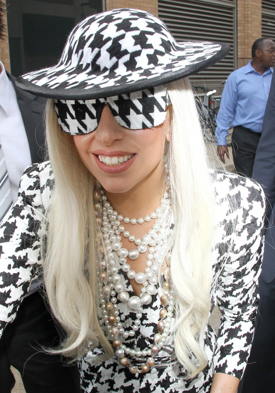 Lady Gaga in Houndstooth sunglasses and everything else! Source news.80spurple.co...