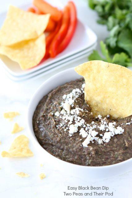Easy Black Bean Dip Recipe on twopeasandtheirpo... This healthy dip only takes 5 minutes to make!