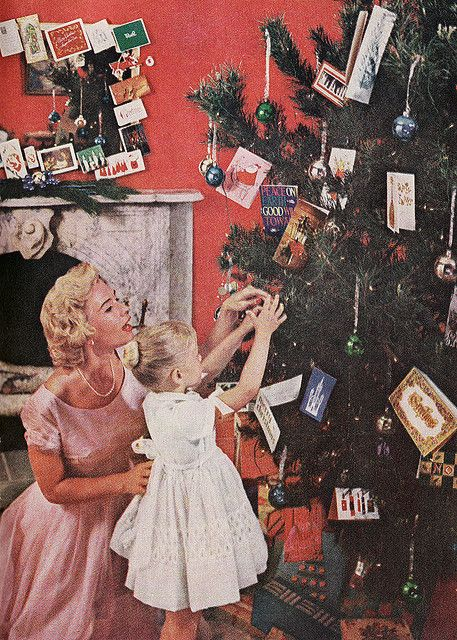 Helping mum decorate the tree (Photo: Vintage Christmas 1959)