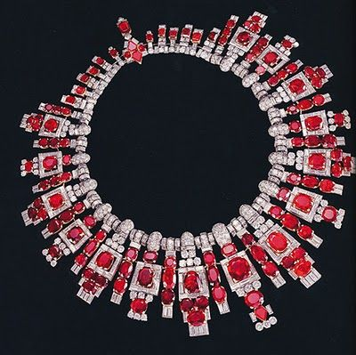 A MAGNIFICENT ART DECO RUBY AND DIAMOND NECKLACE, BY CARTIER   Designed as an oval and cushion-cut ruby and baguette-cut diamond graduated fringe with brilliant-cut diamond detail to the pavé-set and baguette-cut diamond links and rectangular-cut ruby backchain, 36.4 cm. long, with fitted red leather Cartier case ordered by a Maharajah of India