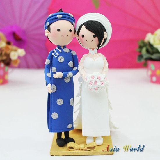 Vietnam Traditional beautiful Ao Dai Wedding cake topper clay doll, Engagement party decoration clay figurine, Bridal shower clay miniature. $73.50, via Etsy.