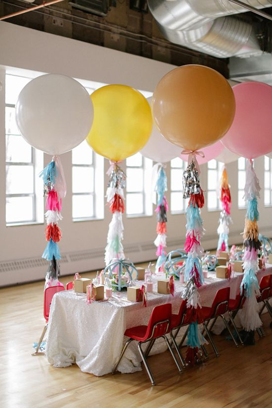 sparkly kids' table with geronimo-style balloons